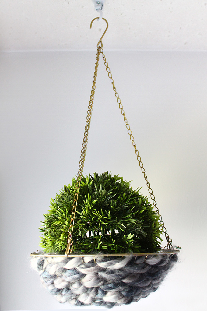 How to turn a hanging fruit basket into a woven hanging planter | Squirrelly Minds