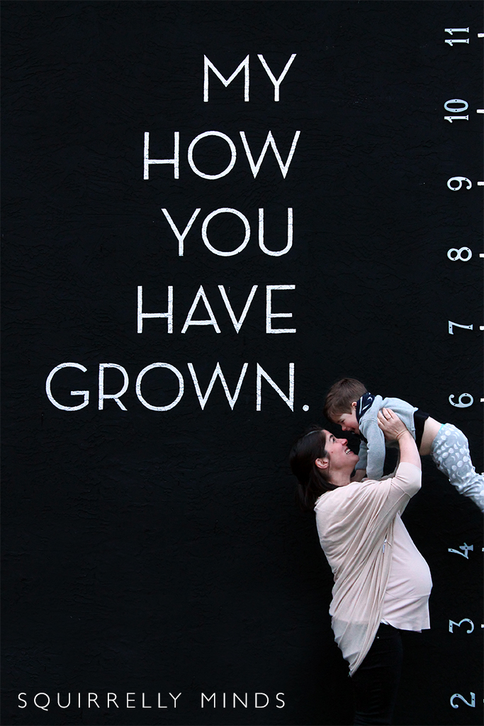 Black background with mother holding up toddler boy and the words written on the wall, my how you have grown - On maternity leave - pregnancy update at 38+ weeks